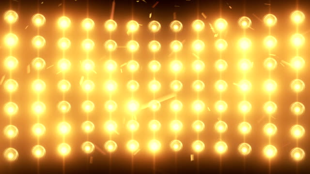 Bright flood lights background with particles and glow video