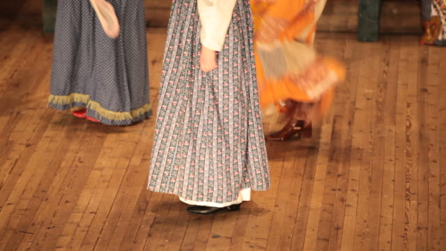 bright fragment of russian folk dance with colorful girls waved skirt - rus kültürü stok videoları ve detay görüntü çekimi