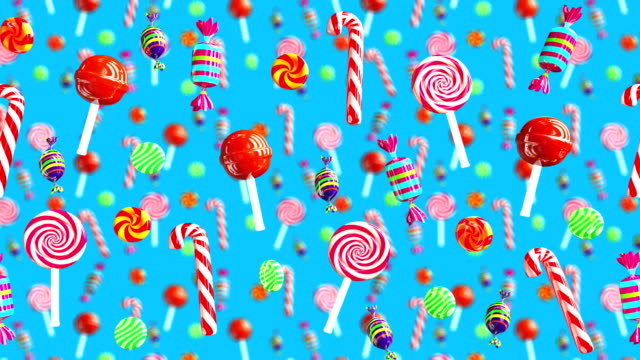 Bright glamour sweet juicy candies lollipop chupa chups caramel toffee sugar move from right to left. High quality background. Candy on blue.