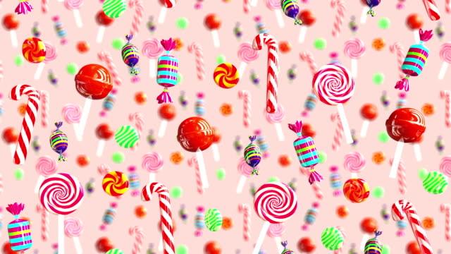 明亮的魅力甜多汁糖果棒棒糖秋巴秋甫斯焦糖太妃糖糖掉下來。高品質的背景。糖果淡粉色。 - 波板糖 個影片檔及 b 捲影像