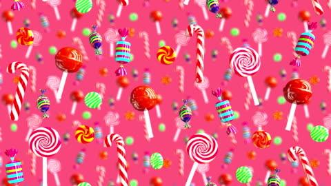 vídeos y material grabado en eventos de stock de caer el azúcar de caramelo toffe de glamour brillante dulce dulces jugosas paleta chupa chups. fondo de alta calidad. candy en rosa roja. - dulces