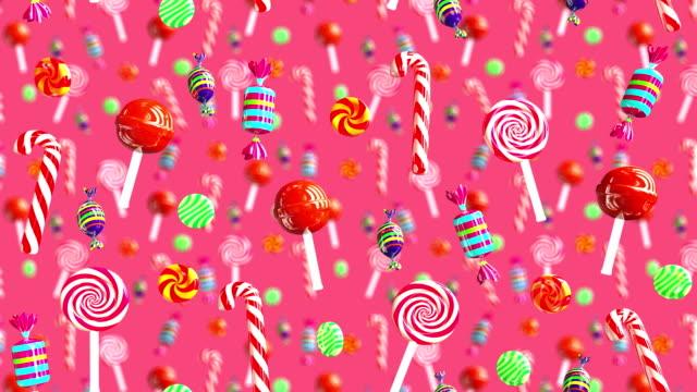 明亮的魅力甜多汁糖果棒棒糖秋巴秋甫斯焦糖太妃糖糖掉下來。高品質的背景。糖果紅色、 粉色。 - 波板糖 個影片檔及 b 捲影像