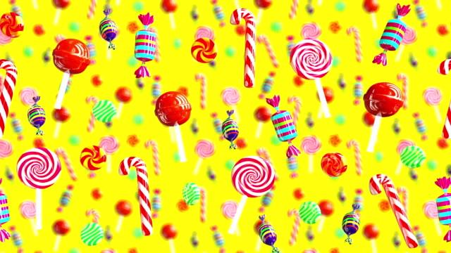 明亮的魅力甜多汁糖果棒棒糖秋巴秋甫斯焦糖太妃糖糖從右至左移動。高品質的背景。糖果黃色。 - 波板糖 個影片檔及 b 捲影像