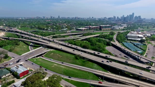 Bright Green Colors of Spring in Central Texas Aerial View of Mopac Expressway and Austin Texas Downtown Skyline normal speed lower down