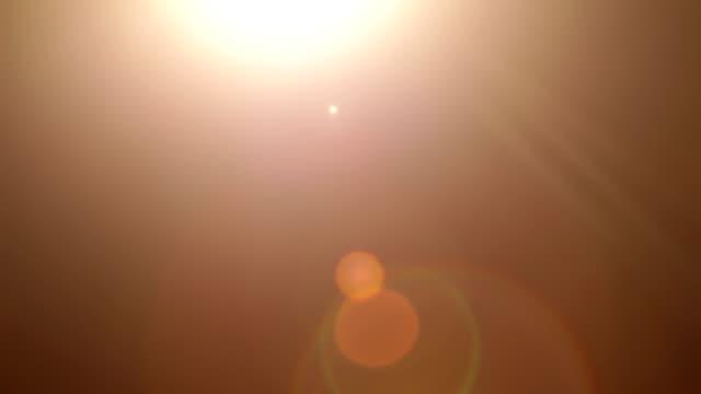 明るいレンズフレアの背景 - 黒色点の映像素材/bロール