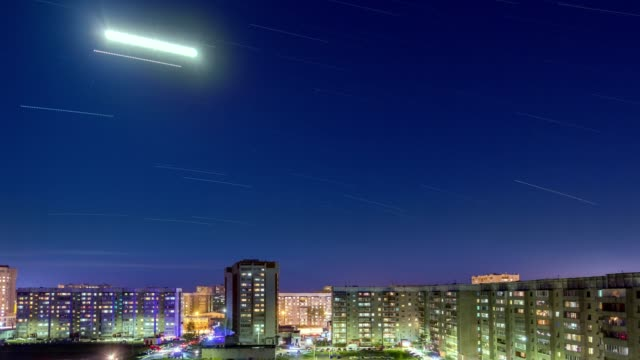 Bright Lunar Trace Over City Residential Area video