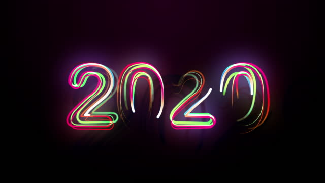 vídeos de stock e filmes b-roll de 2020 bright multicolored animation numerals of the new year flicker and glowing - texto datilografado