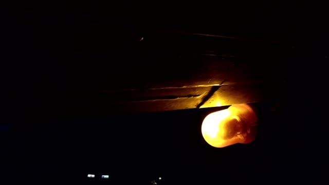 bright orange emergency light glows through the night - rimorchiatore video stock e b–roll