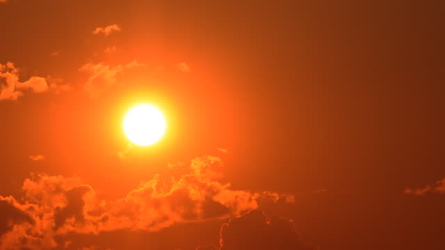 cc31a5dd3d6 Bright orange sunset with clouds video