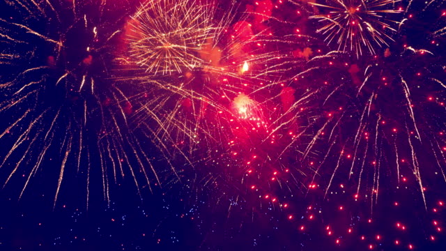Bright splashes of fireworks in the dark sky Bright splashes of fireworks in the dark sky. 4K happy 4th of july videos stock videos & royalty-free footage