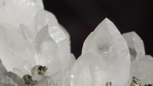 CLOSE UP DOF: Bright white opaque quartz along with glimmering pyrite particles video