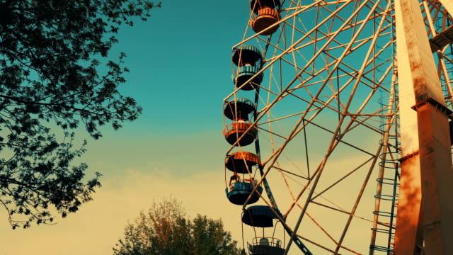 Brightly Coloured Ferris Wheel. Slow motion