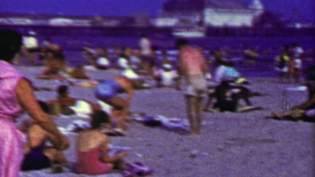 1965: Brighton beach coney island crowds hot summer day. video
