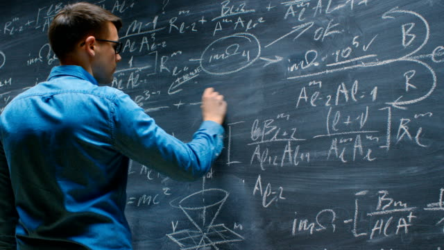 Brilliant Young Mathematician Approaches Big Blackboard and Finishes  writing Sophisticated Mathematical Formula/ Equation. Brilliant Young Mathematician Approaches Big Blackboard and Finishes  writing Sophisticated Mathematical Formula/ Equation. Shot on RED EPIC-W 8K Helium Cinema Camera. complexity stock videos & royalty-free footage