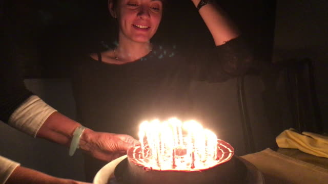 Bringing birthday cake to birthday girl. Young woman celebrating her birthday video