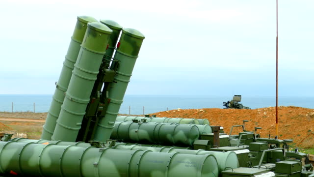 bringing in combat position -anti-aircraft missile system of large and medium range on the coast bringing in combat position - Russian anti-aircraft missile system of large and medium range on the coast nuclear missile stock videos & royalty-free footage