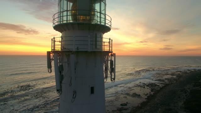 bringing light to the ocean at night - krajobraz morski filmów i materiałów b-roll