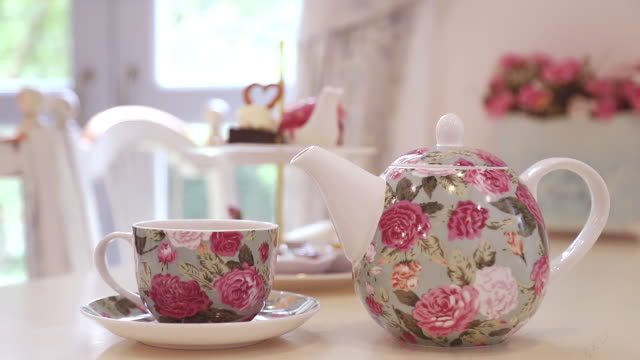 british afternoon tea set on the table with window light in background. - scone filmów i materiałów b-roll