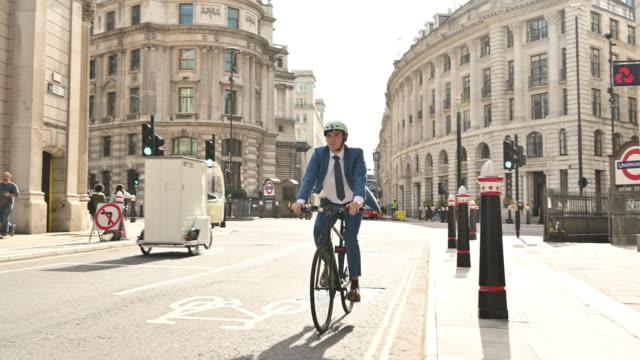 British businessman enjoying freedom of cycling to work