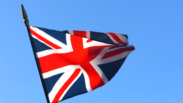 British flag waving in wind against clear blue sky video
