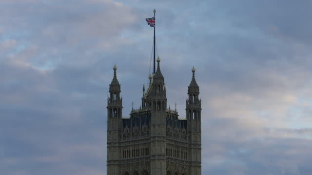 British flag waving on the Palace of Westminster