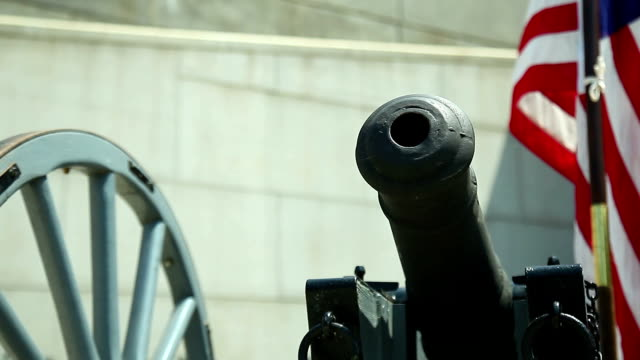 british six-pounder cannon and american flag - independence day stock videos & royalty-free footage