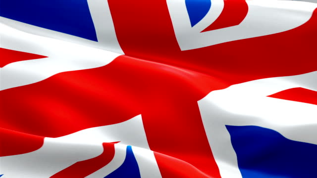 British Union Jack Flag video waving in wind. Realistic UK Flag background. United Kingdom Flag Looping Closeup 1080p Full HD 1920X1080 footage. United Kingdom EU European country flags footage video for film,news