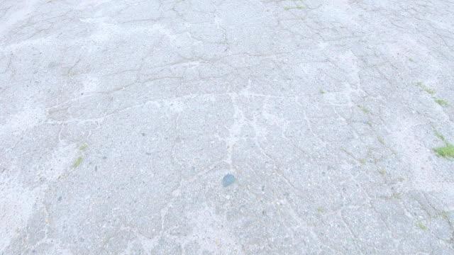 vídeos de stock e filmes b-roll de broken asphalt road - driveway, no people