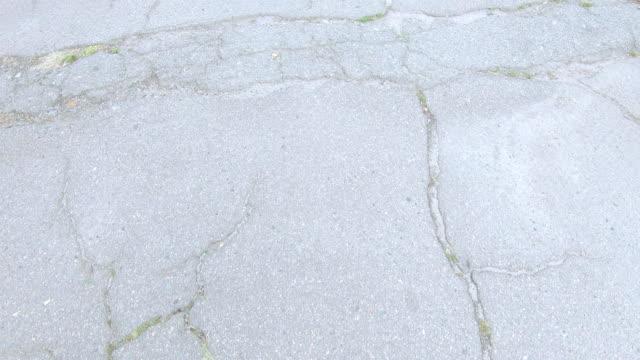 сломанная асфальтовая дорога - бетон стоковые видео и кадры b-roll