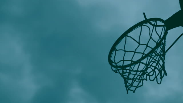 Broken basketball hoop, clouds in the background video