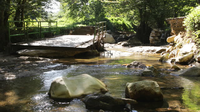 Broken bridge over mountain creek video