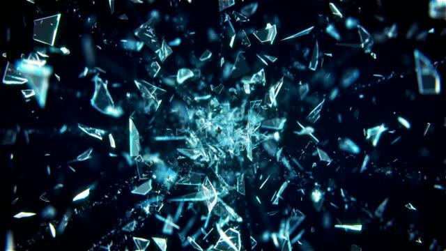 vetro rotto che esplode su sfondo nero in 4k - vetro video stock e b–roll