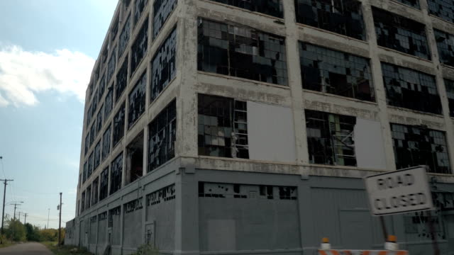 CLOSE UP: Broken glass on the windows of abandoned Fisher auto factory, Detroit video