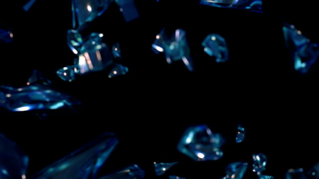 Broken Glass Pieces Animated broken glass on a black background. The fragments slowly fly and rotate. breaking stock videos & royalty-free footage