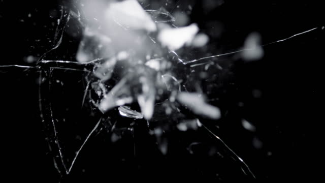 Broken Glass Texture. Isolated Realistic Cracked Crack on the broken glass shards flying through the air after broken window on a black background breaking stock videos & royalty-free footage