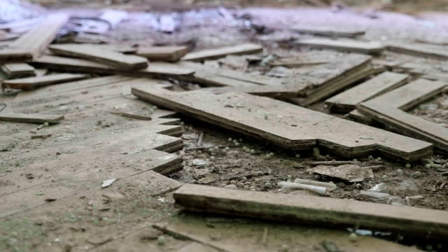 Broken parquet on floor in the abandoned hospital. Smooth and slow dolly shot. video