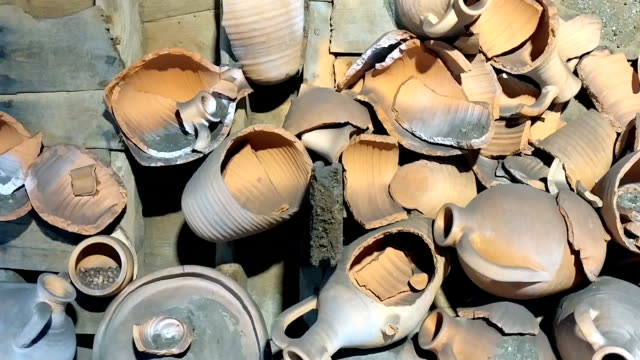 Broken pottery Broken pottery. pot, jug, earthenware pot, crock flower pot stock videos & royalty-free footage