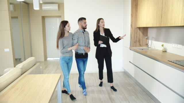 Broker Showing Couple New Flat