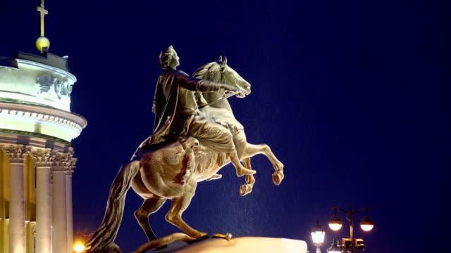 Bronze Horseman sculpture at winter night, side rear view video