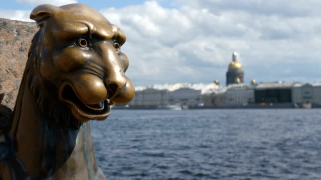 Bronze sculpture of Griffin and the Isaac's Cathedral in the summer - St Petersburg, Russia video