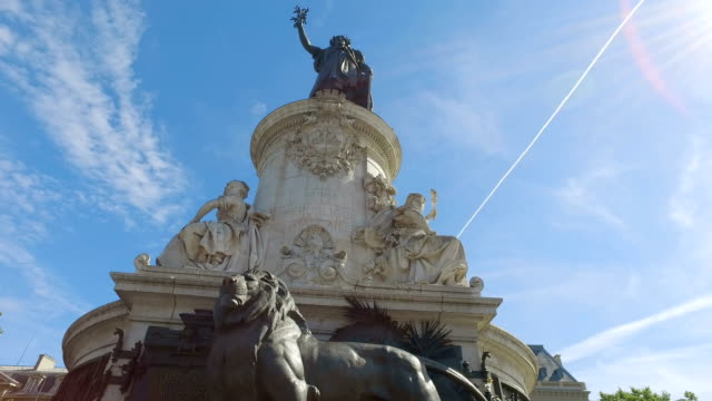 Bronze statue of Marianne holding an olive branch in her right hand, Place de la Republique, Paris, France. hyperlapse video