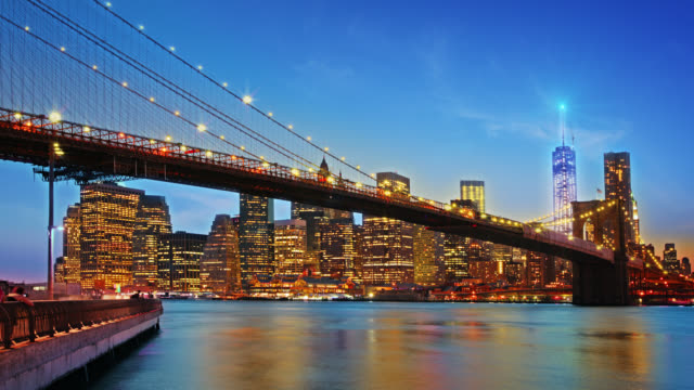 Brooklyn bridge and Freedom tower illuminated at night video