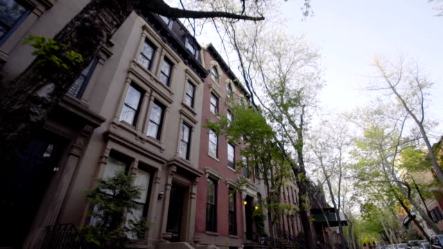 Brooklyn Brownstone view from the street A view of Brooklyn's iconic Brownstone homes from the view of the street. porch stock videos & royalty-free footage
