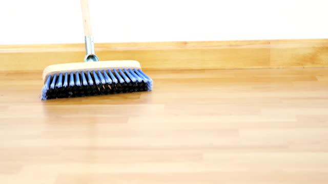 Broom with wooden handle Broom with wooden handle on wooden floor handle stock videos & royalty-free footage