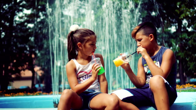 Brother and sister drinking juice video