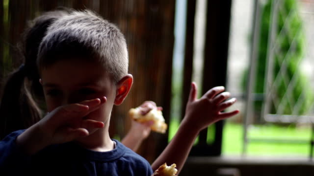 Brother and sister enjoying barbecue video