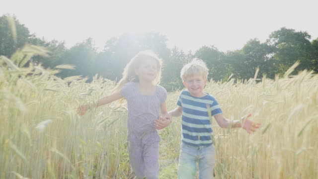 Brother and sister in field