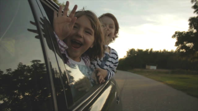 brother and sister brother and sister peeking through the car window road trip stock videos & royalty-free footage
