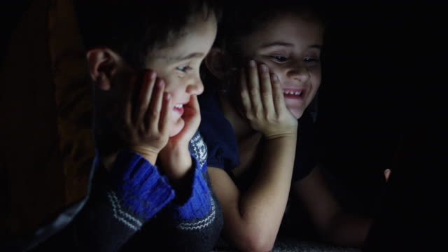 Brother and Sister Watching a Movie video