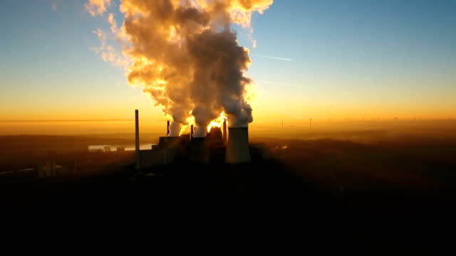 Brown coal power station at dusk video